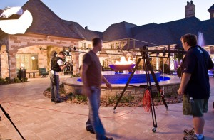 The film crew busy at work as dusk falls upon a pool project at a private residence in Texas