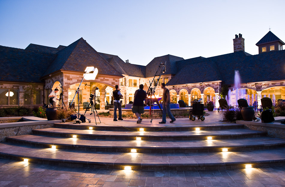 Sean Gallagher and the film crew busy at work as dusk falls upon a pool project at a private residence in Texas